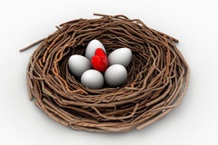 Red heart and eggs in a bird nest Royalty Free Stock Images