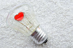 Red heart of an electric bulb Stock Images