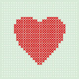 Red heart embroider by thread on turquoise background. Cross stitching on canvas. Stock Image
