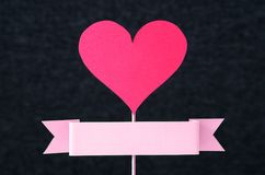 Red heart and empty ribbon with copy space cut from cardboard Stock Image