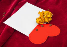 Red heart in the envelope with dried roses and coffee beans Royalty Free Stock Image