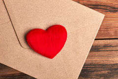 Red heart on envelope. Letter with heart on wood. Send love receive love Royalty Free Stock Image
