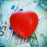 Red heart and euro banknotes Royalty Free Stock Photos