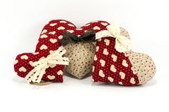 Red Heart family with white and brown bows on white background Stock Images