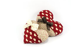 Red Heart family with white and brown bows on white background Royalty Free Stock Photography