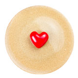 Red Heart on festive  golden  plate  isolated on white backgroun Royalty Free Stock Image