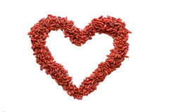 Red heart figure made from many dried Goji berries. Heart sign isolated Royalty Free Stock Photo
