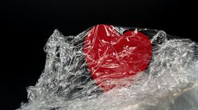 Red heart in the film on a black background close-up stock photos
