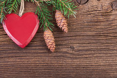 Red Heart with Fir Branch over Wooden Background Royalty Free Stock Photo