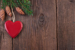 Red Heart with Fir Branch on a Wooden Background Royalty Free Stock Photography