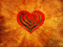 Red heart on fire. Red grunge heart with fire background Royalty Free Stock Image