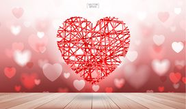 Red heart floating on wood texture background with light blurred Stock Image