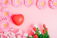Red heart and flower on pink background stock images