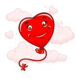 Red heart flying among clouds Royalty Free Stock Image