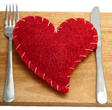 Red heart with a fork Royalty Free Stock Photo