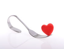 Red heart with fork on white Stock Photography