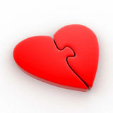 Red heart in the form of a puzzle Royalty Free Stock Images