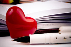 Red heart, fountain pen and notebook Royalty Free Stock Image