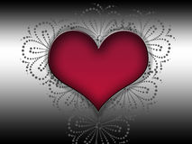 Red heart in front of a black decor background.! Stock Photos