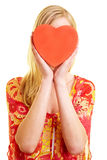 Red heart in front of female face Royalty Free Stock Images