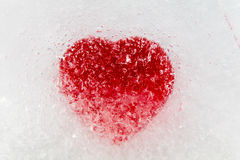 Red heart frozen in ice center Stock Photo