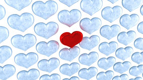 Red heart among frozen ones Royalty Free Stock Photo