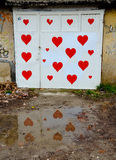 Red heart garage. Car garage decorated by red hearts drawn by kids Royalty Free Stock Photography