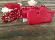 Red heart, gift box beads wooden dating background decorative Royalty Free Stock Image