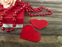 Red heart, gift box beads wooden dating february background decorative Royalty Free Stock Photos