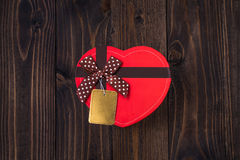 Red heart gift box on wooden background for valentines day Stock Image