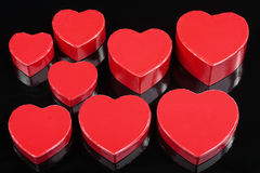 Red heart gift boxes detail  on black Stock Photo