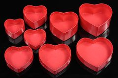 Red heart gift boxes detail  on black Stock Photos