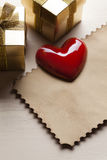 Red heart, gift boxes and paper card Stock Images