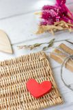Red heart and gift on craft paper on Valentine's day.  royalty free stock photo