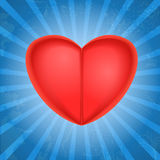Red heart with glowing rays Stock Images