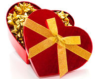 Red heart with gold bows Stock Photo