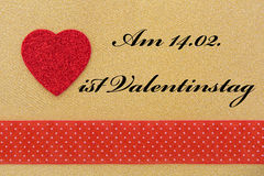 Red heart on golden background Royalty Free Stock Image