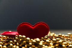 Red heart on the Golden beads.  Stock Photography