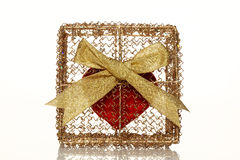 Red heart in a golden gift box. Over white Stock Photos
