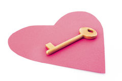 Red heart and golden key Royalty Free Stock Images