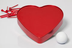 Red heart and golf ball and tees Royalty Free Stock Images