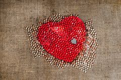 Red heart, gray heart many small transparent pearl Stock Photography