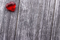 Red Heart on the gray painted wooden background Stock Photos