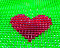 Red heart on green background Stock Image