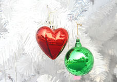 Red heart and green ball Stock Photography
