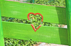 Red Heart and green fence stock image