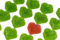 Red heart in green hearts Stock Images