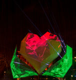 Red heart with green leafs - digital laser show Royalty Free Stock Photo