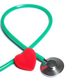 Red heart and green stethoscope  Stock Images