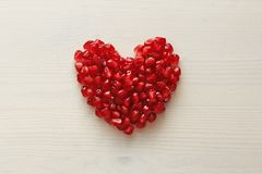 Red Heart of Grenades. Big Ripe Red Granets or Garnets. Fruits o. F Red Ripe Pomegranate on the White Background. Vegetarian Concept, Organic Vitamins, Detox Stock Photography